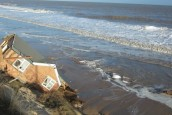 Village devastated as homes fall into the sea after storm