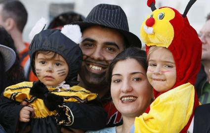 Family in Purim costumes