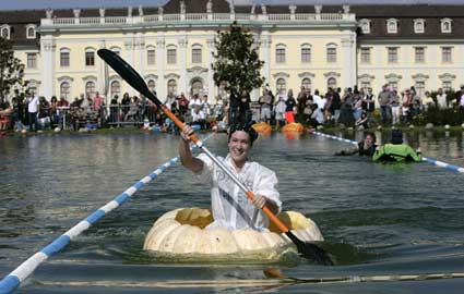 woman paddling pumpkin boat