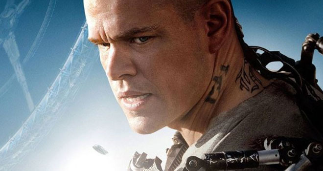 Matt Damon, looking fierce and holding a gun in Elysium