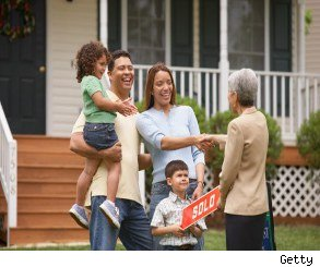 Photo of a family that just bought a house for a story on home buying tips.