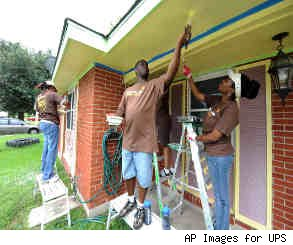 Painting a house for a story on home improvement tips for landlords.