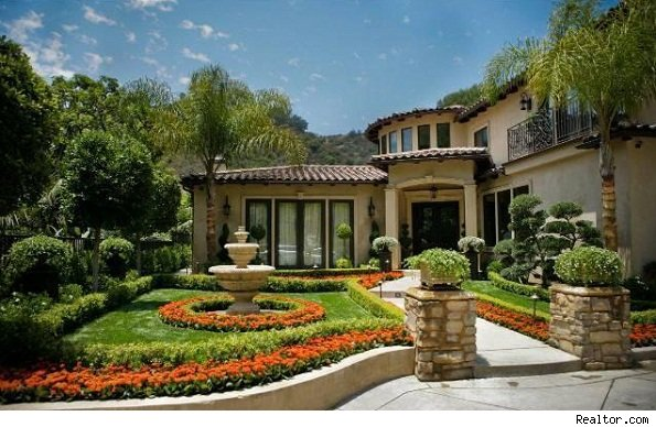 Getting real with dr phil he lists a beverly hills home for Famous homes in beverly hills