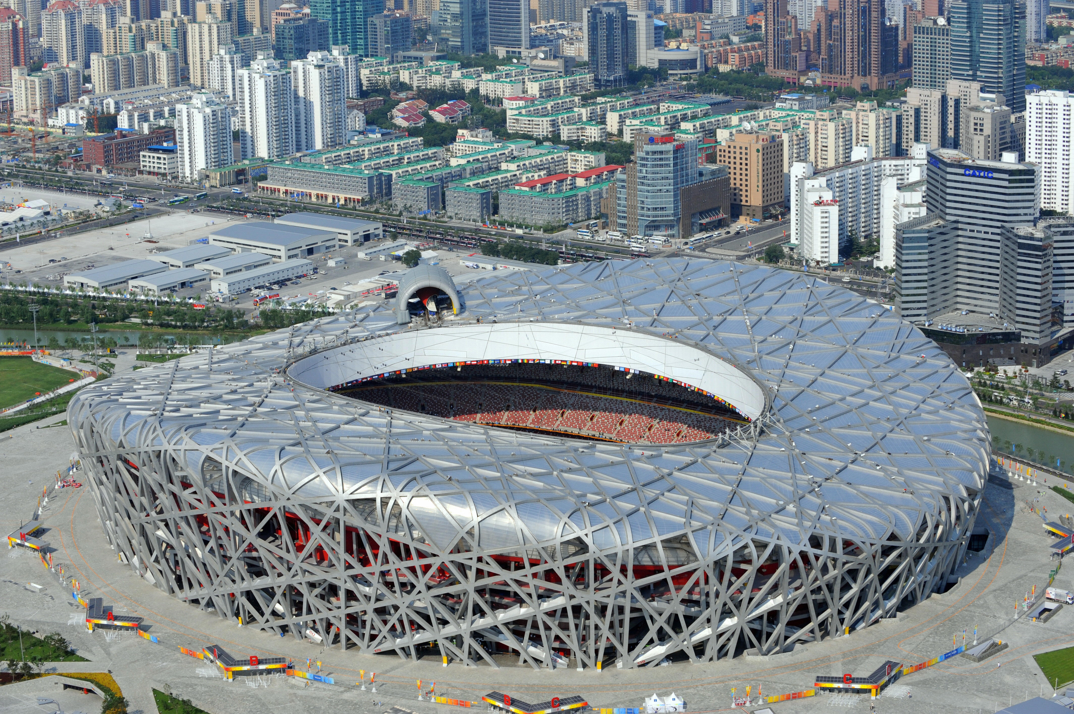 Olympic stadiums then and now for The bird s nest stadium