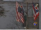 Soldier Flies American Flags Upside-Down to Protest Obama's Re-Election
