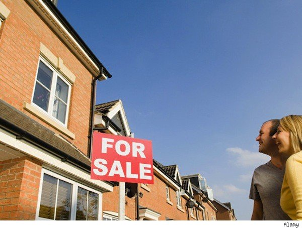 Homebuyers and for sale sign