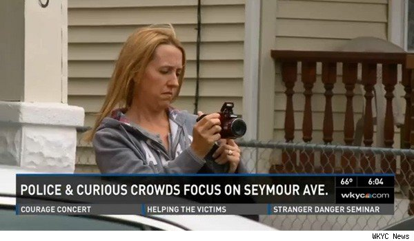Visitor with camera at Ariel Castro home