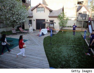 backyard with wood deck and lawn