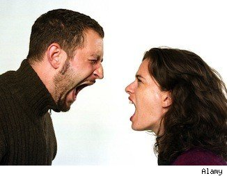 man and woman angrily shouting at each other