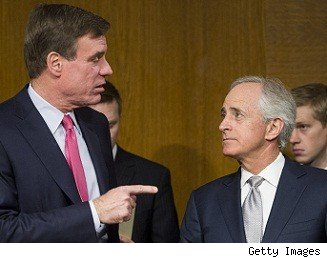 Sen. Mark Warner, D-Va., left, speaks with Sen. Bob Corker, R-Tenn.