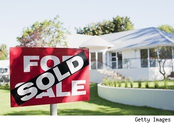 sold sticker on home for sale sign
