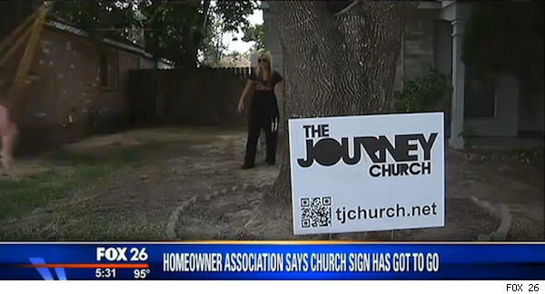 Meagan Schmidt stands behind Journey Church sign in front yard