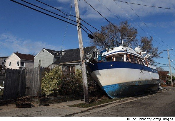 In the aftermath of Hurricane Sandy, boats continue to litter Hudson Avenue on November 2, 2012 in Freeport, New York. With the death toll continuing to rise and millions of homes and businesses without power, the U.S. east coast is attempting to recover from the effects of floods, fires and power outages brought on by Superstorm Sandy.