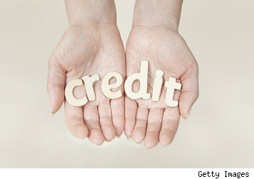 outstretched hands holding the word credit