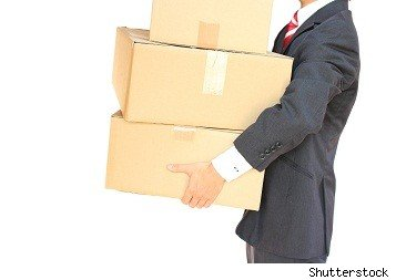 moving boxes carried by man in suit