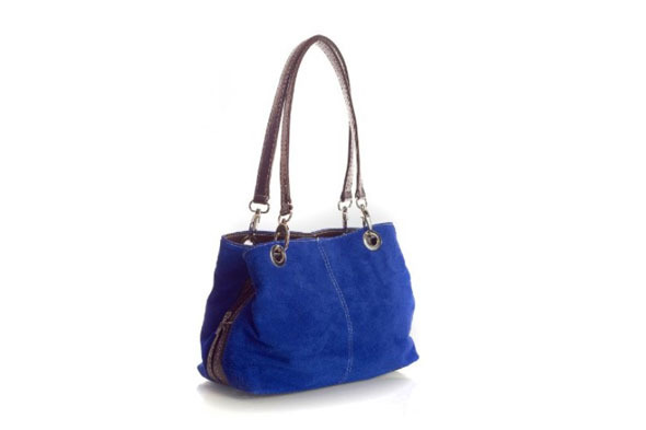 crafted from quality italian suede this compact shoulder bag comes