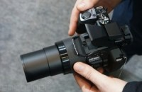 Aiming Olympus' Stylus SP-100, the 50x superzoom camera with a gun sight (hands-on)