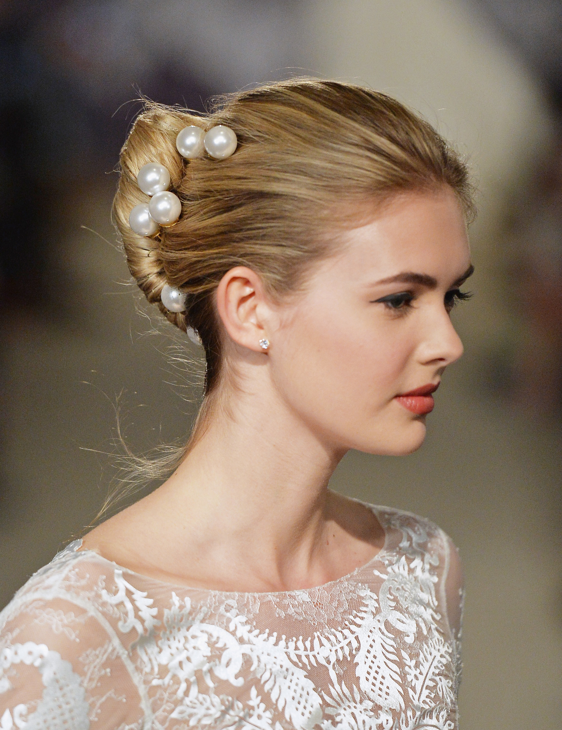 liven up a classic chignon with bold hair accessories pearl