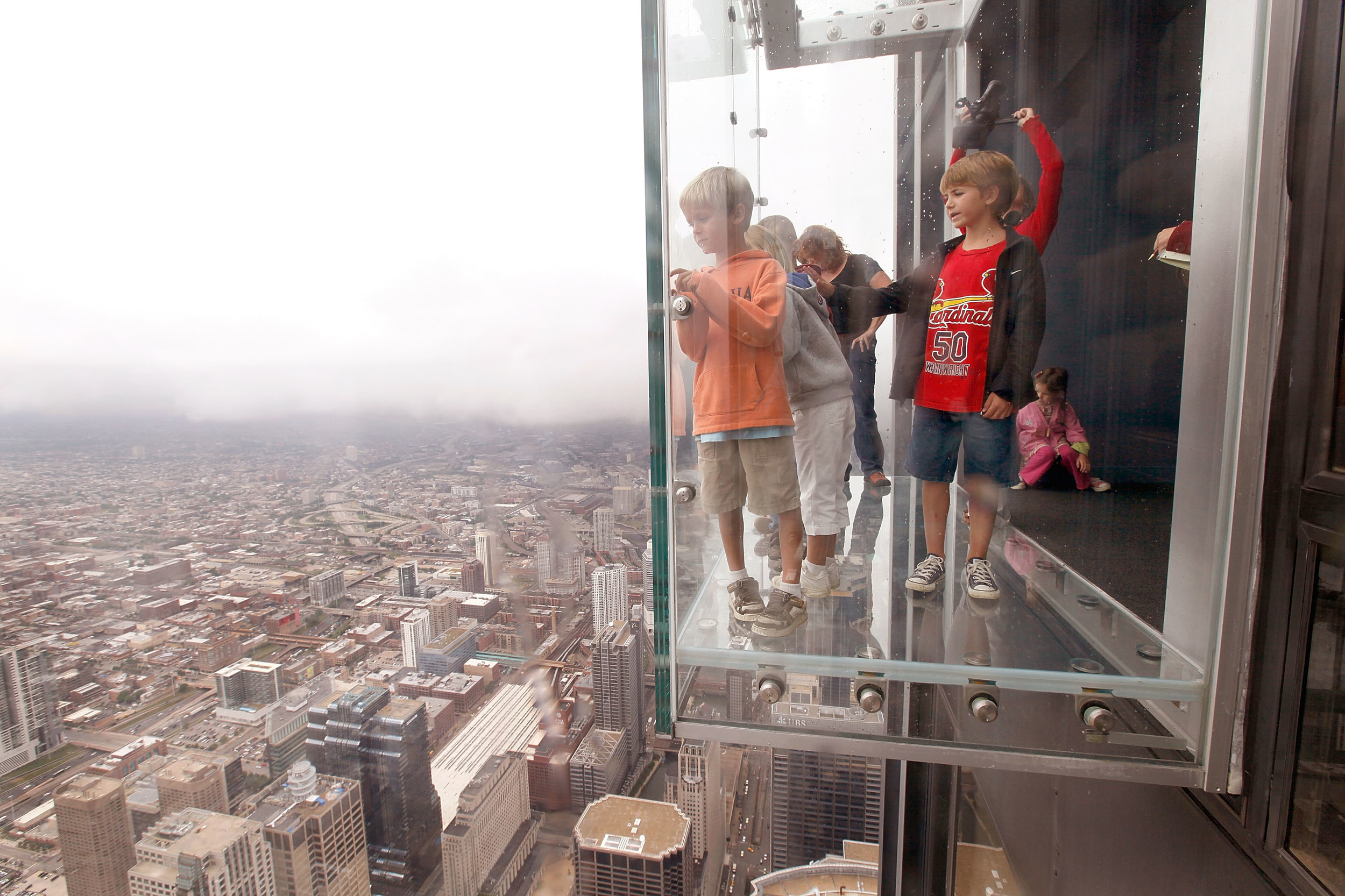Protective coating on Willis Tower Ledge cracks under ...