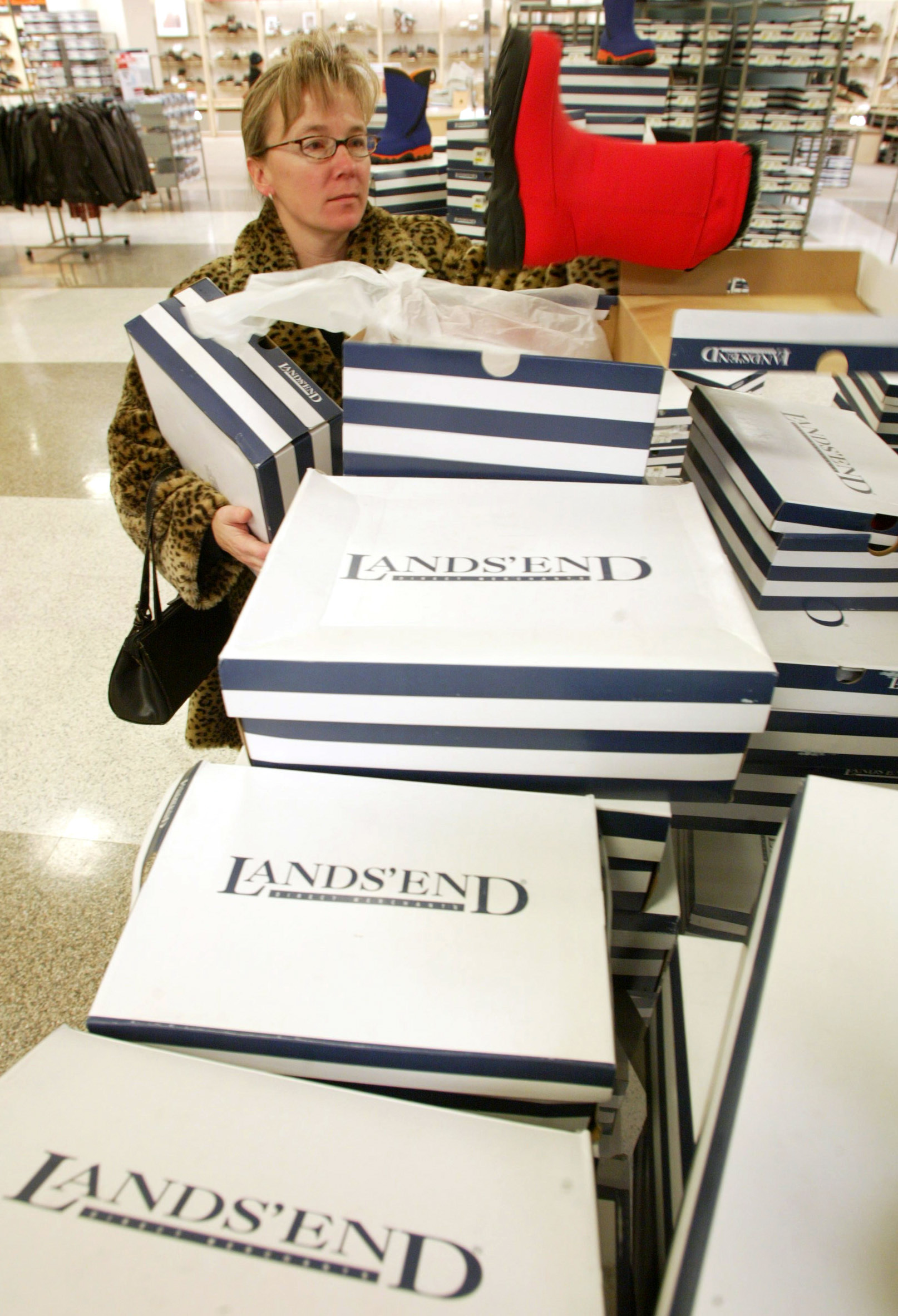 Faye Jaraczwski shops for Lands' End boots at a Sears store