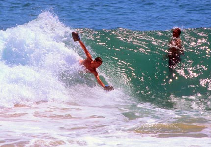 Surfin' safari: Mike Sick's Surf-Grip allows amateur bodysurfers to catch waves.
