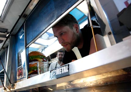Would you like fries with that? Grill Em All co-founder Matt Chernus takes an order.