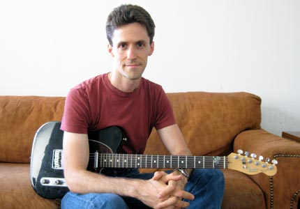 Paper trail: Dan Smith's fliers, promoting his guitar lessons, can be seen all over New York.