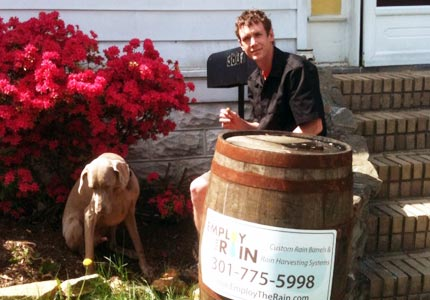 Barrel of fun: Mark Lutz recycles plastic and wooden barrels and transforms them into backyard rain barrels.