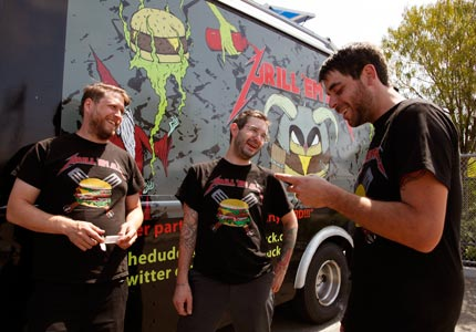Smoking the competition: Grill Em All's Matt Chernus, Joel Brown and Ryan Harkins took top honors on The Food Network's Great Food Truck Race.