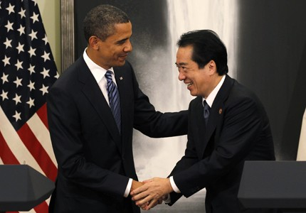 Let's shake on it: President Obama and Japanese Prime Minister Naoto Kan exchange a handshake described by experts as