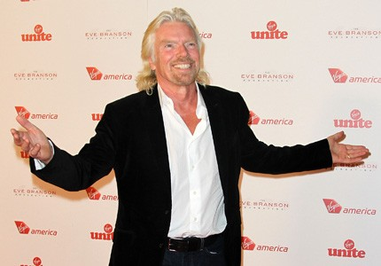 Ready for takeoff: Sir Richard Branson will dress up as a stewardess after losing a bet to AirAsia CEO Tony Fernandes.