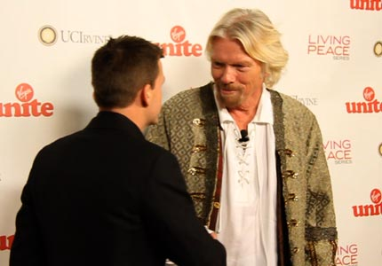 Meeting of the moguls: Sir Richard Branson greets Rob Dyrdek at a charity benefit at the Center for Living Peace