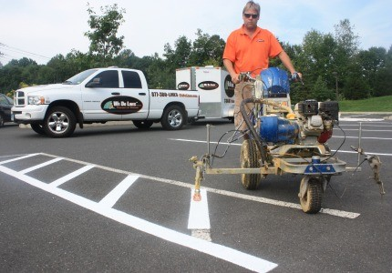 Line up: We Do Line's Chris Couri, Dan Rella and Tom Darrow now have 17 parking-lot striping franchises up and down the East Coast.