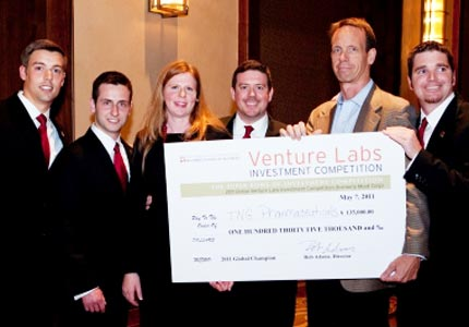 Winning: Rob Adams awards a check to TNG Pharmaceuticals, the winning team from this year's Texas Venture Labs Investment Competition.