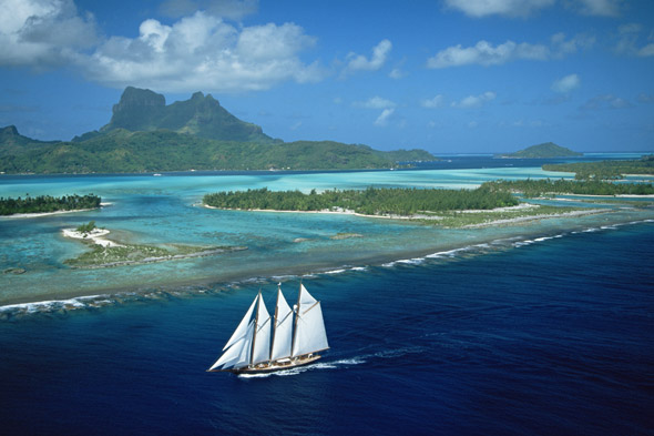 A three-masted schooner on the north west reef of Bora Bora, French Polynesia