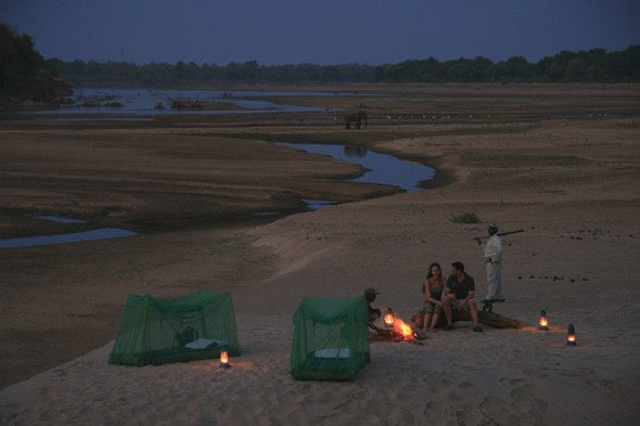 Sleep under the stars in the wild on a Zambian safari
