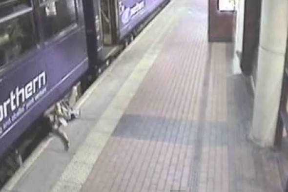 Drunk' woman falling under train footage released as Christmas warning