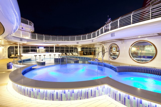 This adults' relaxing area features a multi-level pool with varying ...