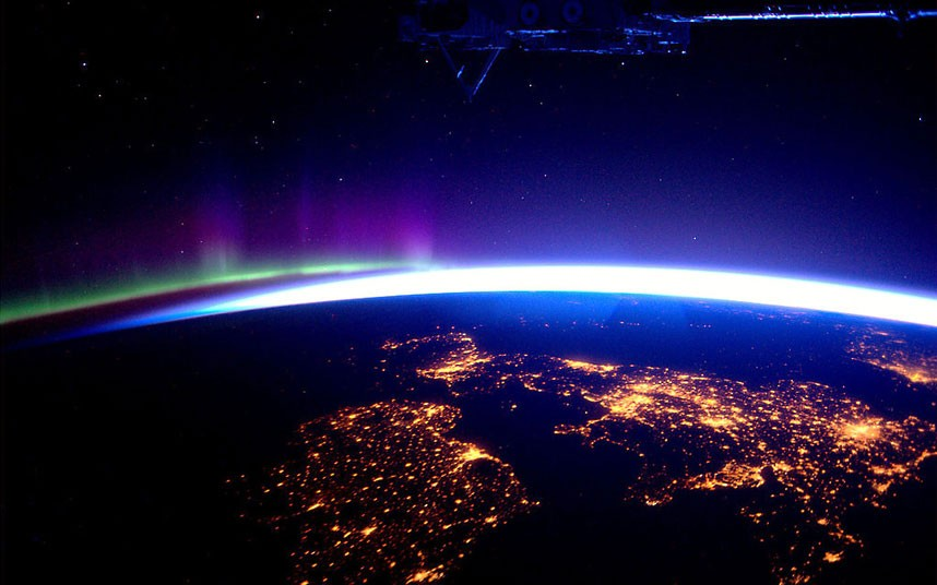 The UK and Ireland by night, with the Northern Lights on the horizon
