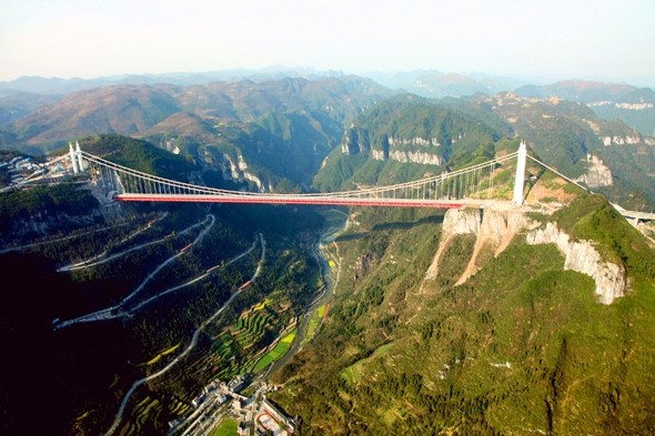 World's highest suspension bridge Aizhai opens to public in China