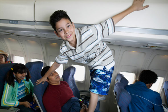 Put a child in an overhead locker