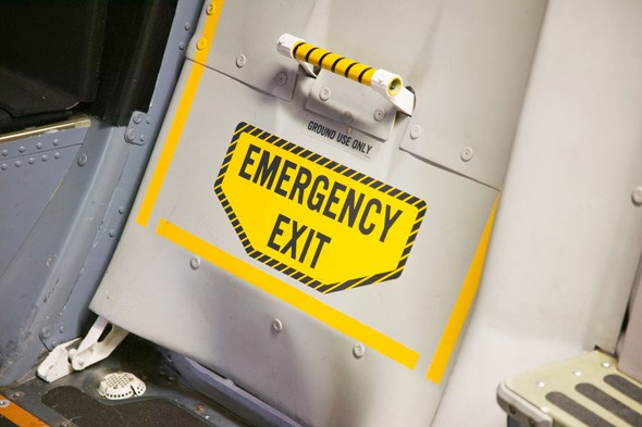 Try to open the emergency exit