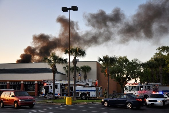 Panic as plane crashes into Florida shopping centre and bursts into flames
