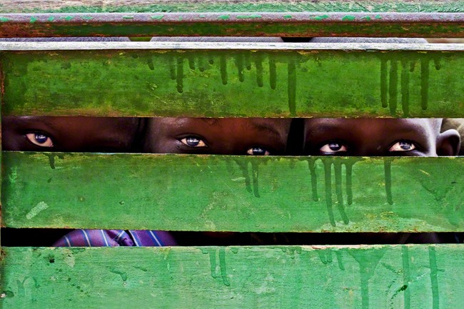 Three children playing hide and seek, Senegal