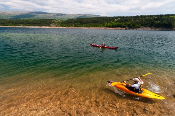 Work those arms and kayak through the River Cetina