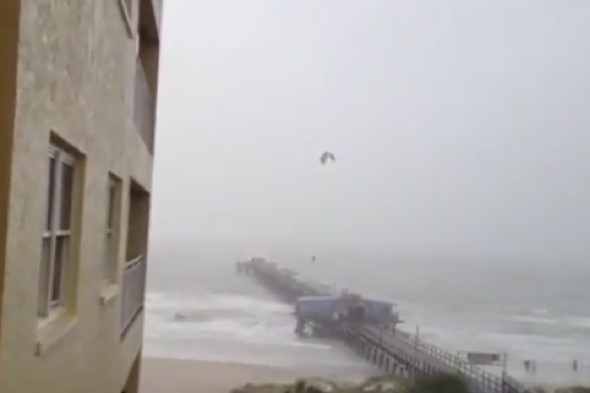 Video: Kite surfer jumps over an entire pier during tropical storm