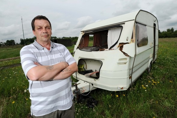 Tornado lifts caravan in the air - with granddad relaxing inside