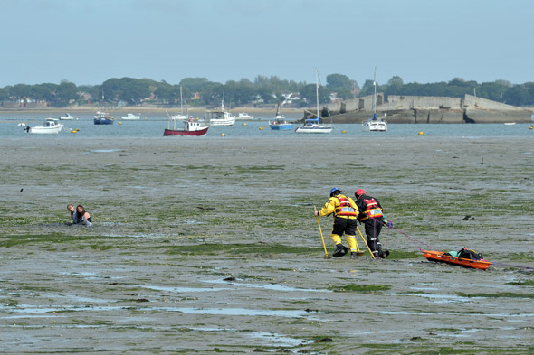 Girls stuck waist-deep in mud rescued by coastguard