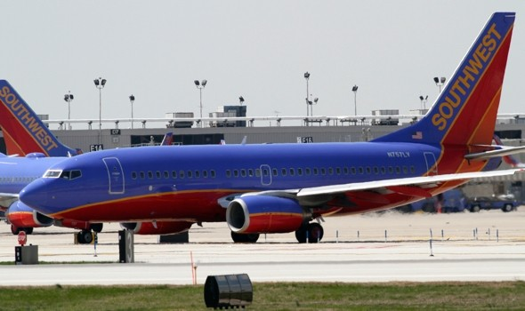 Plane returns to airport after 'strange smell' causes flight attendant sickness