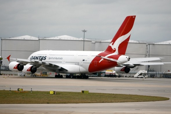 Banker kicked off Qantas flight for 'refusing to turn off mobile phone'